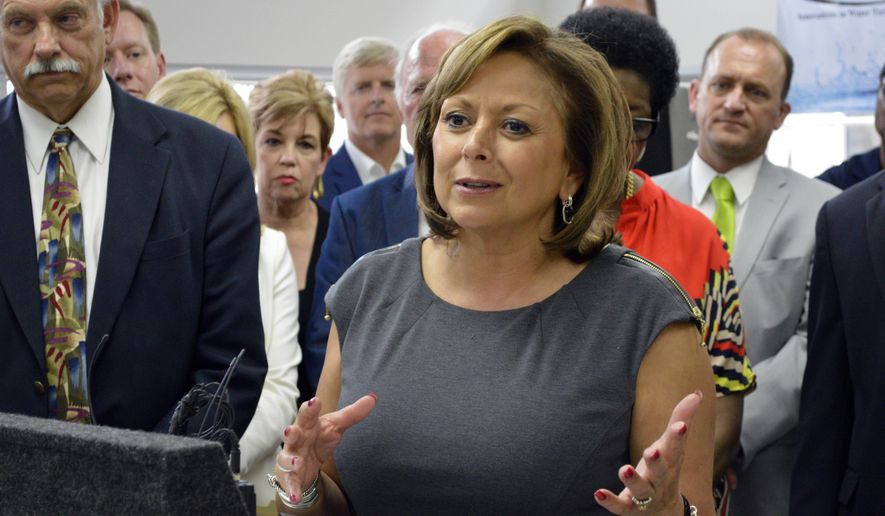 New Mexico Gov. Susana Martinez speaks to business leaders at the Bioscience Center in Albuquerque on Monday, June 15, 2015 before signing a bill on a set of tax incentives passed by lawmakers during a special session last week. Martinez said the measure would help attract businesses to the state. (AP Photo/Russell Contreras)