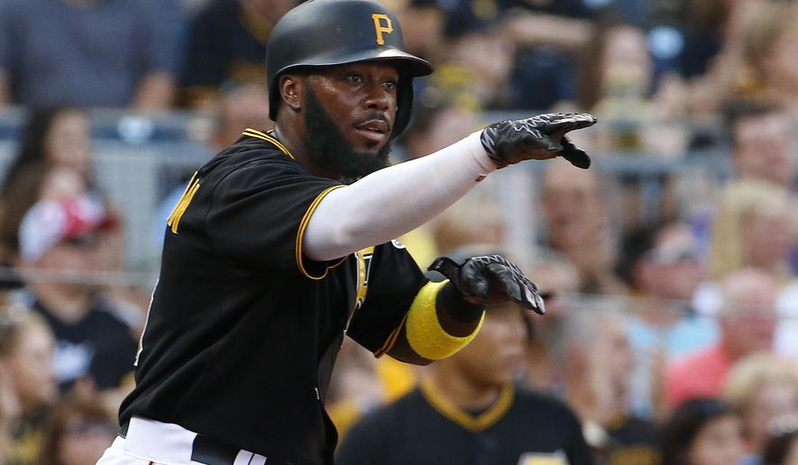 Pittsburgh Pirates' Josh Harrison celebrates after scoring on a single by Andrew McCutchen off Chicago White Sox starting pitcher Carlos Rodon during the first inning of a baseball game in Pittsburgh, Monday, June 15, 2015. (AP Photo/Gene J. Puskar)