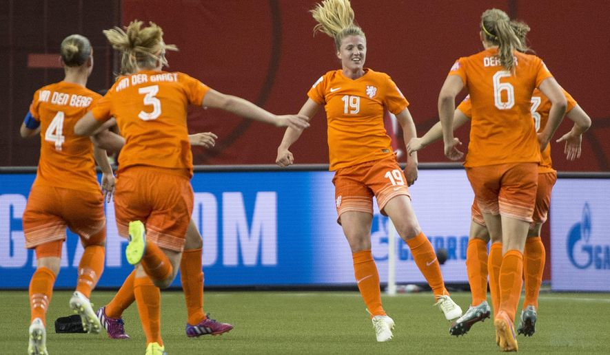 Netherlands forward Kirsten Van De Ven (19) celebrates her goal against Canada during the second half of a FIFA Women's World Cup soccer match Monday, June 15, 2015, in Montreal, Canada. (Paul Chiasson/The Canadian Press via AP)