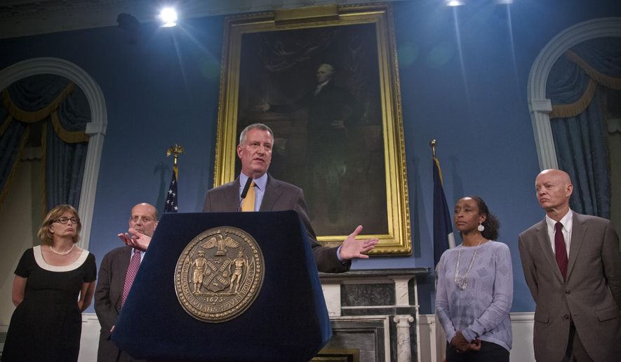 Commissioner of Housing Preservation and Development Vicki Been, far left, Commissioner of Human Resources Steve Banks, second from left, Mayor Bill  de Blasio, center, Legal Aid Society attorney-in-charge Adriene Holder, second from right, and Legal Services NYC executive director Raun Rasmussen hold a press conference, Monday June 15, 2015, at City Hall in New York.  The mayor and his housing team outlined the city's response if state lawmakers can't strike a deal before a midnight deadline on rent regulation.  (AP Photo/Bebeto Matthews)