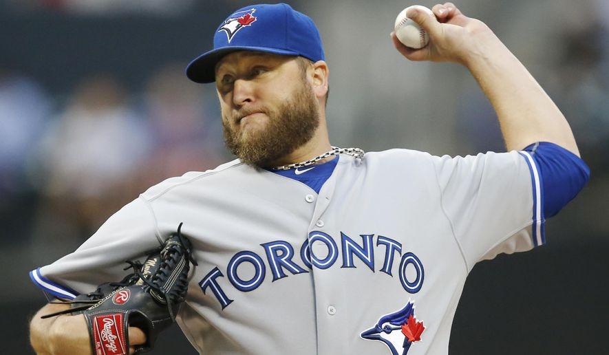 Toronto Blue Jays starting pitcher Mark Buehrle delivers in the first inning of a baseball game against the New York Mets in New York, Monday, June 15, 2015. (AP Photo/Kathy Willens)