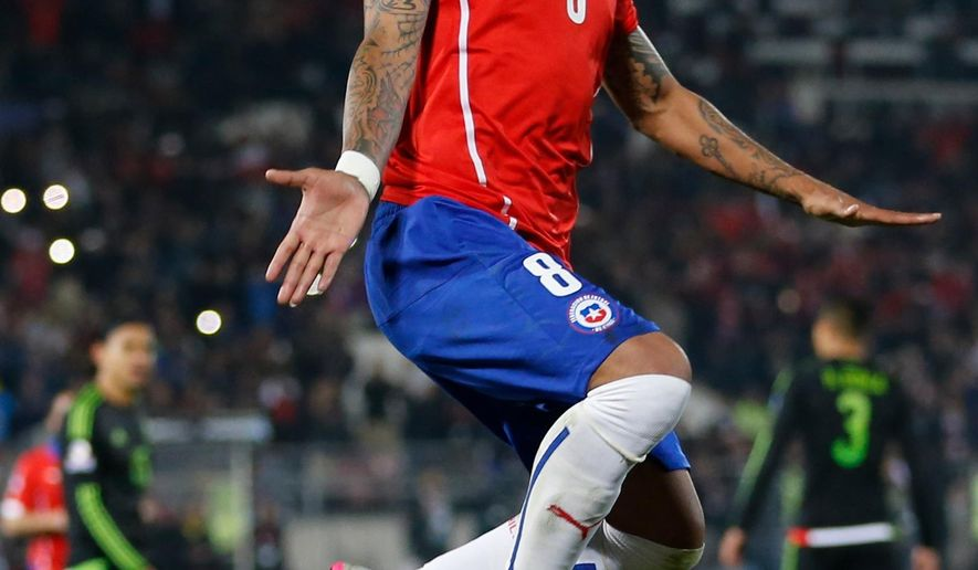 Chile's Arturo Vidal celebrates after scoring  against Mexcico during a Copa America Group A soccer match at El Nacional stadium in Santiago, Chile, Monday, June 15, 2015. (AP Photo/Silvia Izquierdo)
