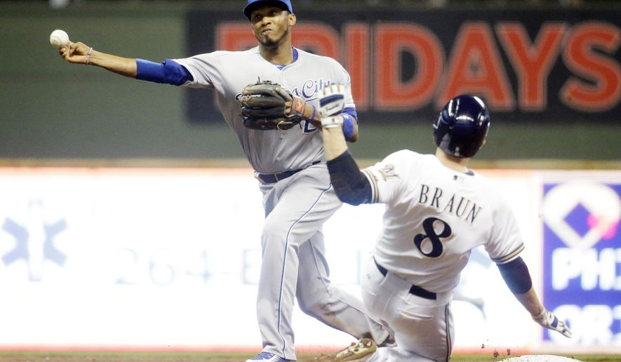 Milwaukee Brewers' Ryan Braun is out at second as Kansas City Royals' Alcides Escobar turns a double play on a ball hit by Adam Lind during the first inning of a baseball game Monday, June 15, 2015, in Milwaukee. (AP Photo/Morry Gash)
