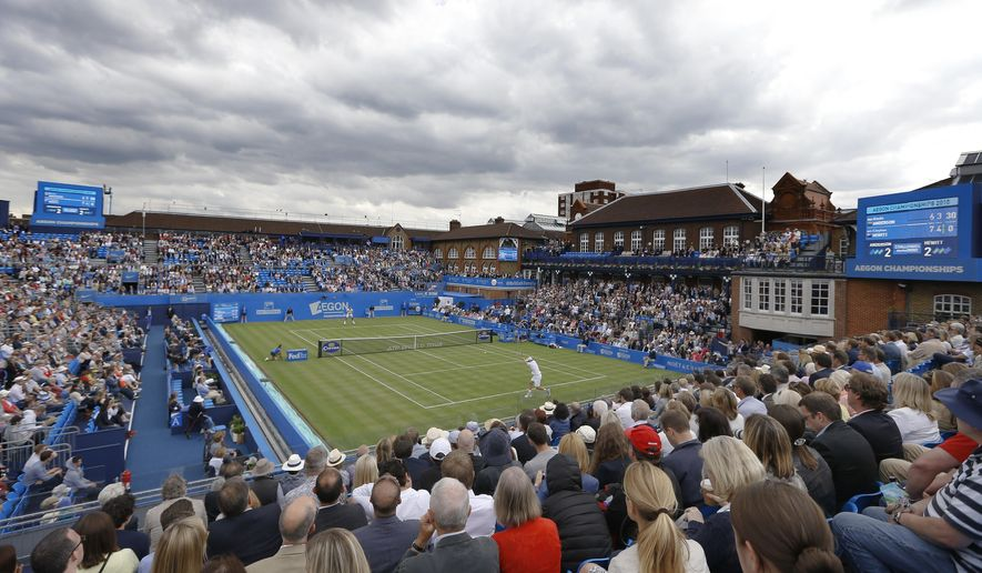 Clouds hang over Queens Club as Lleyton Hewitt of Australia plays Kevin Anderson of South Africa at the Aegon Tennis Championships in London, Monday, June 15, 2015. (AP Photo/Kirsty Wigglesworth)