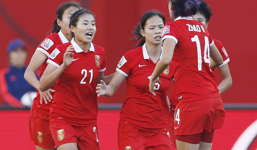 China's Lisi Wang (21) celebrates scoring against New Zealand on the penalty shot during FIFA Women's World Cup first half soccer action in Winnipeg, Manitoba, Canada,  on Monday, June 15, 2015. (John Woods/The Canadian Press via AP) MANDATORY CREDIT