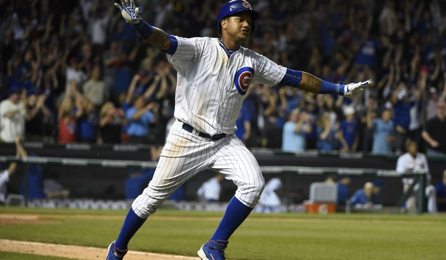 Chicago Cubs' Starlin Castro celebrates his game-winning hit against the Cincinnati Reds during the 11th inning of a baseball game, Sunday, June 14, 2015 in Chicago. The Cubs won 2-1. (AP Photo/David Banks)