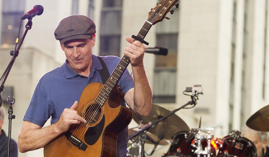 """James Taylor performs on NBC's """"Today"""" show during the Toyota Summer Concert Series on Monday, June 15, 2015, in New York. (Photo by Charles Sykes/Invision/AP)"""