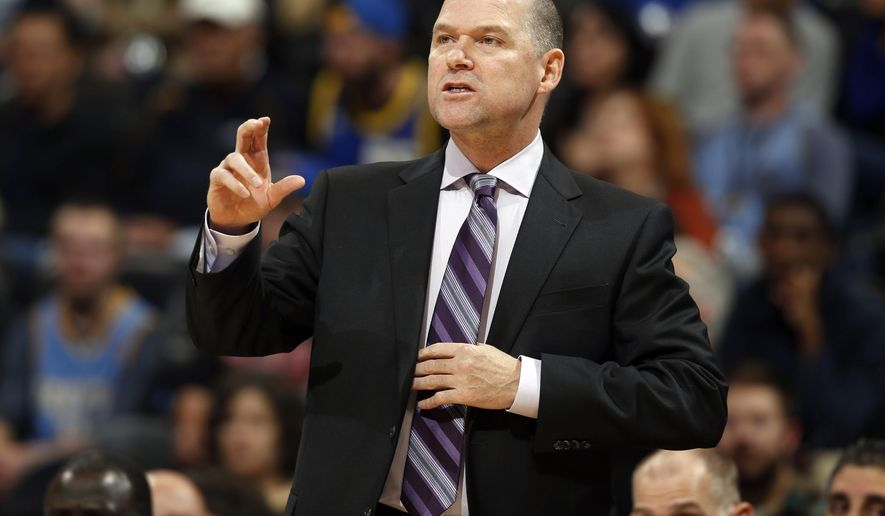 FILE - In this photo taken Nov. 3, 2014, Sacramento Kings coach Michael Malone directs his team against the Denver Nuggets in the first quarter of an NBA basketball game in Denver.  A person familiar with the decision says the Denver Nuggets have reached an agreement to make Malone their new coach. The person spoke to The Associated Press on condition of anonymity Monday, June 15, 2015, because the hiring has yet to be announced. (AP Photo/David Zalubowski, File)