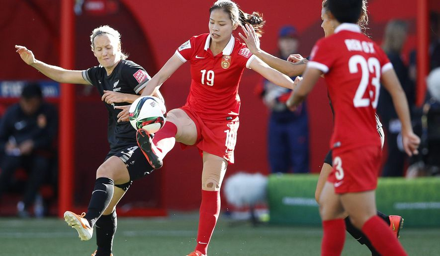 China's Ruyin Tan (19) and New Zealand's Katie Duncan vie for the ball during FIFA Women's World Cup first half soccer action in Winnipeg, Manitoba, Canada,  on Monday, June 15, 2015. (John Woods/The Canadian Press via AP) MANDATORY CREDIT