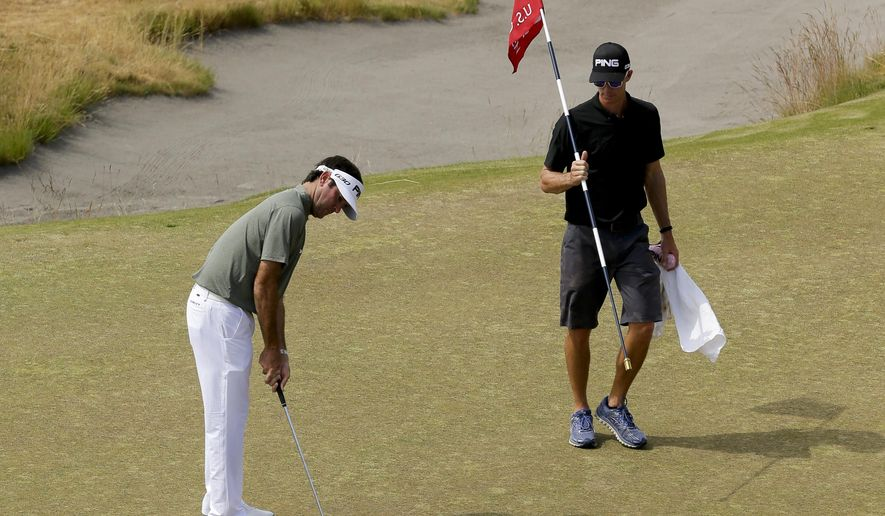 Bubba Watson watches his putt on the fourth hole during a practice round for the U.S. Open golf tournament at Chambers Bay on Monday, June 15, 2015 in University Place, Wash. (AP Photo/Ted S. Warren)
