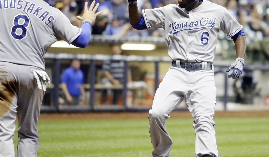 Kansas City Royals' Lorenzo Cain is congratulated by Mike Moustakas after hitting a two-run home run during the fifth inning of a baseball game against the Milwaukee Brewers Monday, June 15, 2015, in Milwaukee. (AP Photo/Morry Gash)