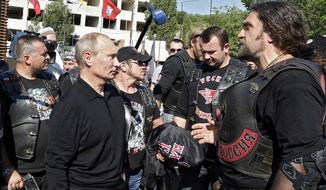 Russian President Vladimir Putin has allied himself with Alexander Zaldostanov, also known as The Surgeon, the leader of the Night Wolves biker group. (Associated Press)