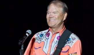 Glen Campbell raised money for research and awareness of Alzheimer's before the disease forced him off stage. (Associated Press)