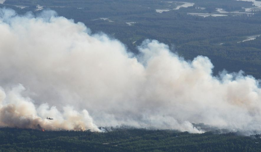 A State Division of Forestry air tanker works the Sockeye fire north of Kashwitna Lake on Sunday, June 14, 2015 near Willow, Alaska. The wildfire north of Anchorage shut down a key highway and forced the evacuation of 1,700 homes after it mushroomed in size. (Bill Roth / Alaska Dispatch News via AP) MANDATORY CREDIT KTUU-TV OUT; KTVA-TV OUT; THE MAT-SU VALLEY FRONTIERSMAN OUT