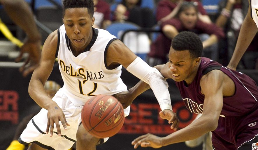 FILE - In this March 14, 2015, file phot, DeLaSalle guard Jarvis Johnson (12) and Johnson's Malik Jones, right,  battle for the ball during the Class 3A boys high school basketball championship in Minneapolis. The University of Minnesota announced Monday, June 15, 2015, that Johnson, a top incoming freshmen, has been denied medical clearance to play for the team. The Minneapolis native will remain on scholarship with the program, but will not be able to take the court with the rest of the Gophers this season.  (AP Photo/Andy King, File)