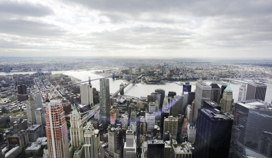 FILE - This May 20, 2015 file photo shows New York's Financial District, foreground, the Brooklyn Bridge and East River, center, and in the distance Brooklyn as seen from the observatory at One World Trade Center.  The Federal Reserve Bank of New York on Monday, June 15, 2015 said that its Empire State manufacturing index fell to negative 2 this month, down from plus 3 in May. (AP Photo/Mark Lennihan, File)