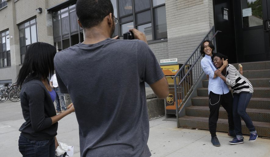 In this Friday, June 5, 2015 photo, Roshana Paul, left, Dexter Dugar Jr., second from left,  Justin Casquejo, second from right, and Tayana Brumaire make a short film in New York. This summer, thousands of young people will go to camp, attend prestigious academic programs and even study filmmaking in Paris thanks to online crowdfunding sites like Kickstarter and Indiegogo. (AP Photo/Mary Altaffer)