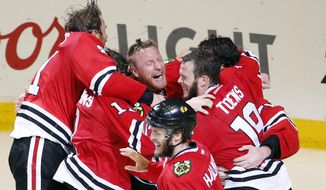Members of the Chicago Blackhawks celebrate after defeating the Tampa Bay Lightning in Game 6 of the NHL hockey Stanley Cup Final series on Monday, June 15, 2015, in Chicago. The Blackhawks defeated the Lightning 2-0 to win the series 4-2. (AP Photo/Charles Rex Arbogast)