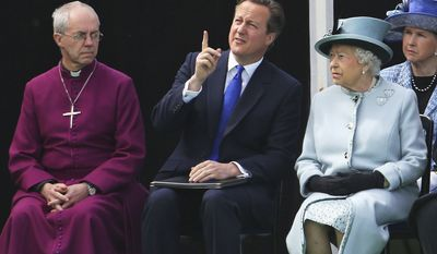 Seated near the Magna Carta memorial at Runnymede, England, are from left, The Archbishop of Canterbury Justin Welby, Prime Minister David Cameron, and Queen Elizabeth II, ahead of a commemoration ceremony Monday June 15, 2015, to celebrate the 800th anniversary of the groundbreaking accord called Magna Carta. (Associated Press) ** FILE **