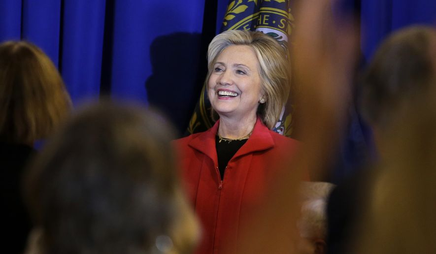 Democratic presidential candidate Hillary Rodham Clinton smiles as she is introduced before addressing an audience during a campaign stop at a Flag Day dinner, Monday, June 15, 2015, in Manchester, N.H. (AP Photo/Steven Senne)
