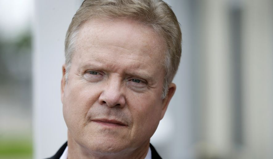 Former Virginia Sen. Jim Webb talks with employees of the Rippey Wind Farm in Grand Junction, Iowa, during a tour on June 15, 2015. (Associated Press) ** FILE **