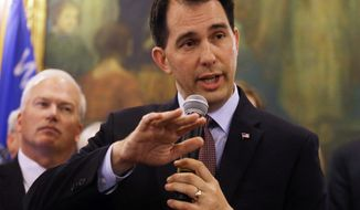 Wisconsin Gov. Scott Walker talks about a deal to pay for a new arena for the Milwaukee Bucks at a news conference in Madison, Wis., on June 4, 2015. (Associated Press) **FILE**