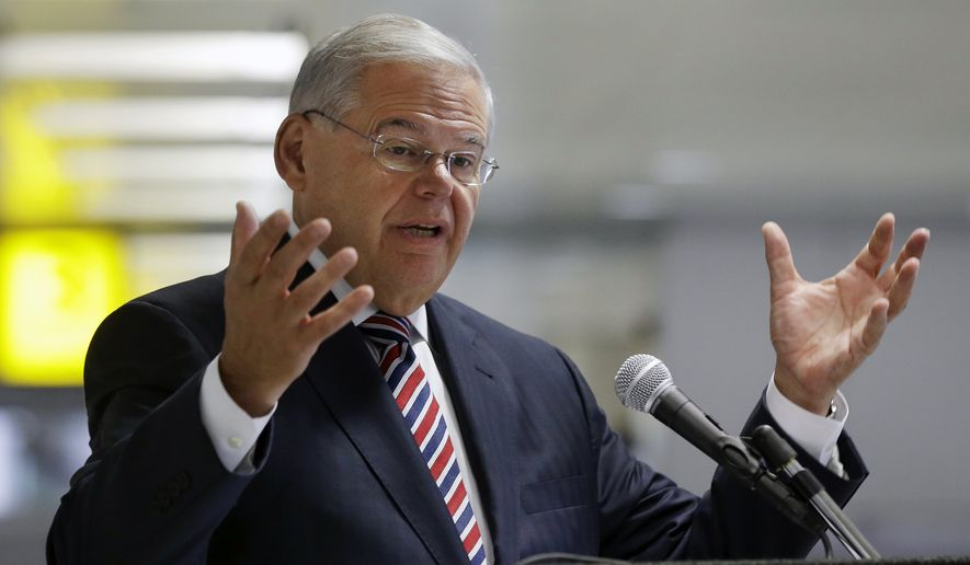 Sen. Bob Menendez, D-N.J., addresses a gathering, as he criticizes new rules proposed to reduce the size of airline travelers' carry-on bags, Monday, June 15, 2015, at Newark Liberty Airport in Newark, N.J. (AP Photo/Mel Evans)