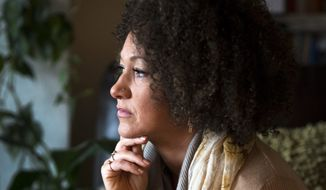 In this March 2, 2015, file photo, Rachel Dolezal, president of the Spokane chapter of the NAACP, poses for a photo in her Spokane, Wash., home. Dolezal resigned Monday, June 15, 2015, amid a furor over racial identity that erupted when her parents came forward to say she has been posing as black for years when she is actually white. (Colin Mulvany/The Spokesman-Review via AP, File)