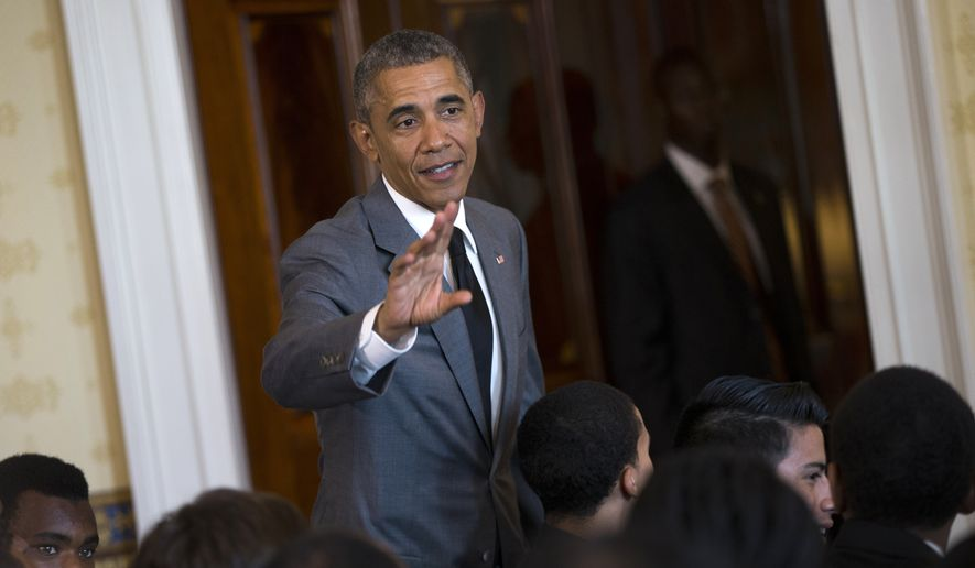 President Barack Obama waves after speaking at a White House mentorship and leadership graduation ceremony , Monday, June 15, 2015, in the Blue Room of the White House in Washington (AP Photo/Evan Vucci)