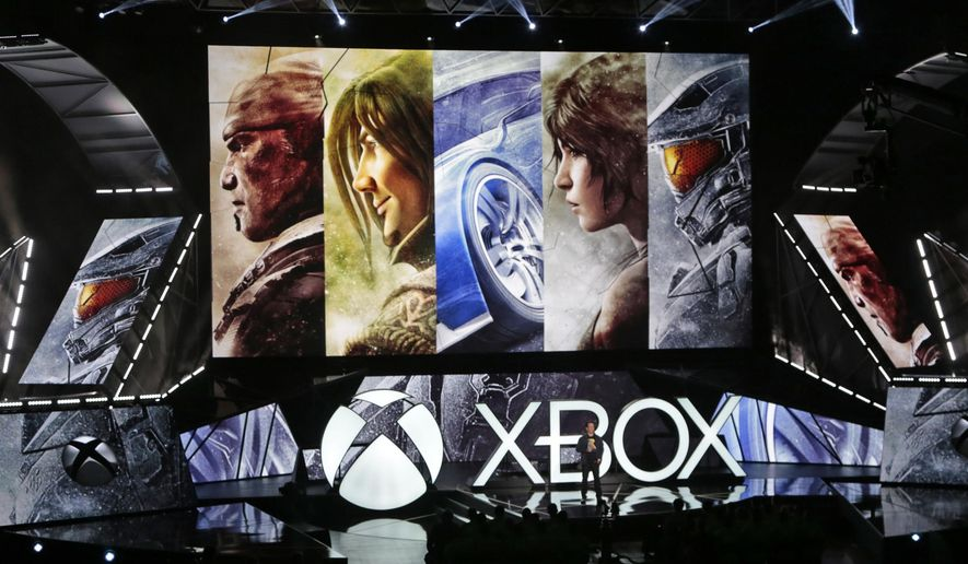 """Phil Spencer, head of Microsoft's Xbox division and Microsoft Studios, speaks at the Xbox E3 2015 briefing ahead of the Electronic Entertainment Expo (E3) at the University of Southern California's Galen Center on Monday, June 15, 2015 in Los Angeles. Microsoft is promoting the next installment in its popular sci-fi franchise, """"Halo 5: Guardians,"""" at E3. (AP Photo/Damian Dovarganes)"""
