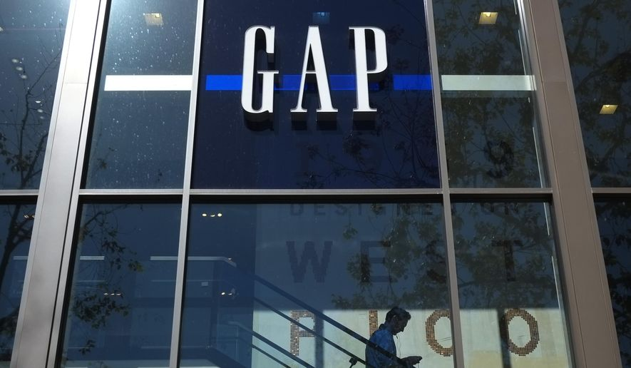 FILE - In this Feb. 26, 2013, file photo, a shopper walks down the steps at a Gap store in Los Angeles. Gap Inc., which owns Gap, Old Navy and Banana Republic, said Monday, June 15, 2015, it will close about 140 Gap stores in North America in the fiscal year that ends Jan. 31. (AP Photo/Jae C. Hong, File)