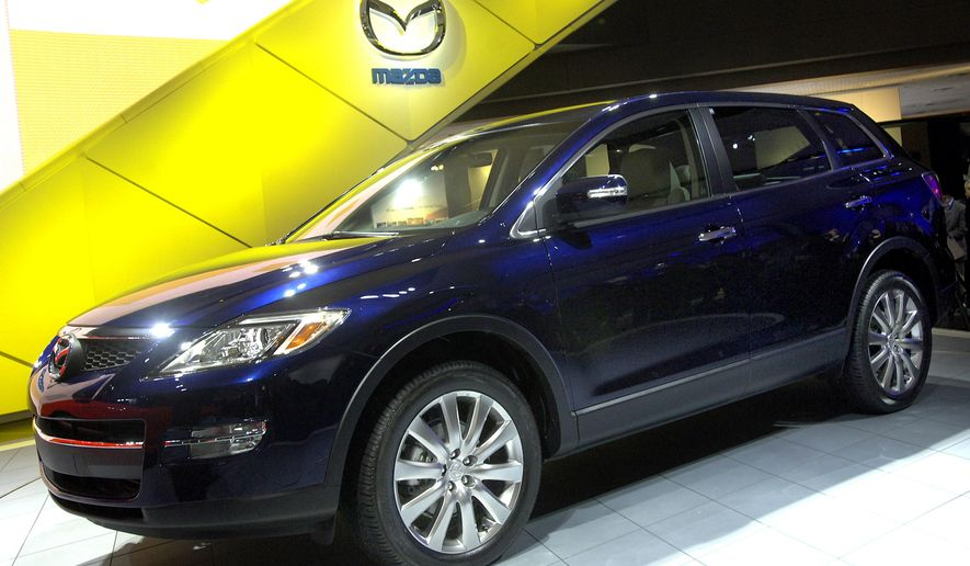 FILE - This April 13, 2006 file photo shows the seven passenger Mazda CX-9 SUV during the 106th New York International Auto Show at the Javits Convention Center in New York. U.S. safety regulators on Monday, June 15, 2015 said they are investigating complaints that suspension parts can come loose on some Mazda CX-9 SUVs from the 2007 and 2008 model years, causing drivers to lose control. (AP Photo/Jason DeCrow)