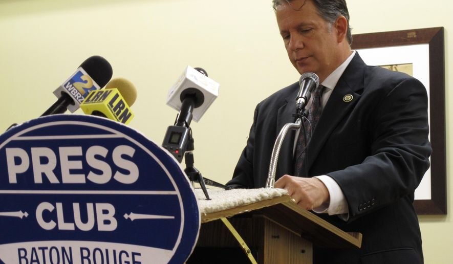 House Ways and Means Committee Chairman Joel Robideaux, R-Lafayette, looks at his notes as he speaks to the Press Club of Baton Rouge about the just-ended legislative session, on Monday, June 15, 2015, in Baton Rouge, La. Robideaux defended the tax changes lawmakers made, saying they protected higher education and health care from cuts. (AP Photo/Melinda Deslatte)