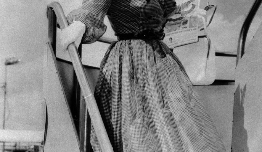 FILE - In this Sept. 2, 1959, file photo, Blaze Starr, a burlesque star and stripper, arrives in New Orleans by plane from Miami to visit Louisiana Gov. Earl K. Long. Starr, whose affair with the governor gained notoriety for both parties, has died. She was 83. Starr's nephew, Earsten Spaulding, said she died Monday, June 15, 2015, at her Wilsondale, W. Va., home. He said she had experienced heart issues the past few years. (AP Photo/File)