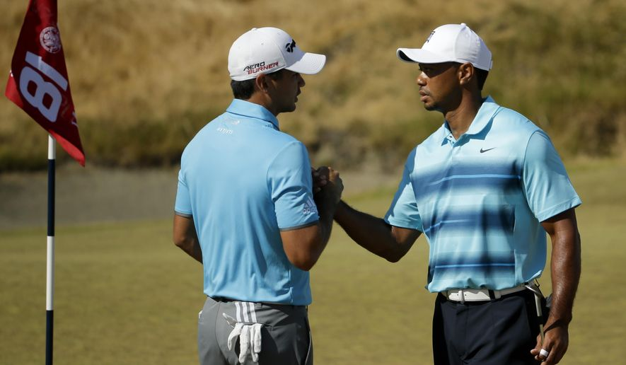 Tiger Wood, right, shakes hands with Jason Day, of Australia, after playing a practice round for the U.S. Open golf tournament at Chambers Bay, Monday, June 15, 2015, in University Place, Wash. (AP Photo/Ted S. Warren)