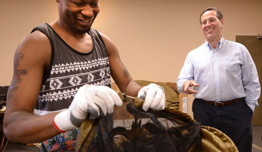 Republican presidential hopeful Rick Santorum, right, watches Tyrone Henderson assemble a tent during a campaign stop at MMI Outdoor, a manufacturer of products used by the U.S. Military and USDA Forest Service firefighters, Monday, June 15, 2015 in Montgomery, Ala. A runner-up to Mitt Romney in 2012, Santorum last month launched his second bid for the presidency.  (Julie Bennett/The Birmingham News via AP)