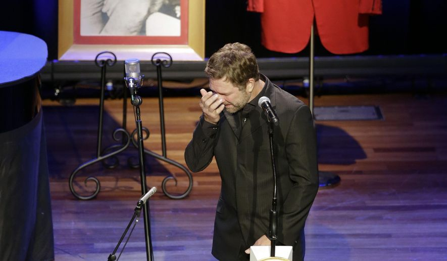 Craig Morgan wipes away tears as he performs during the funeral service for country music performer Jim Ed Brown at the Ryman Auditorium on Monday, June 15, 2015, in Nashville, Tenn. Brown, who was a member of the Grand Ole Opry and was recently elected to the Country Music Hall of Fame, died June 11. He was 81. (AP Photo/Mark Humphrey)