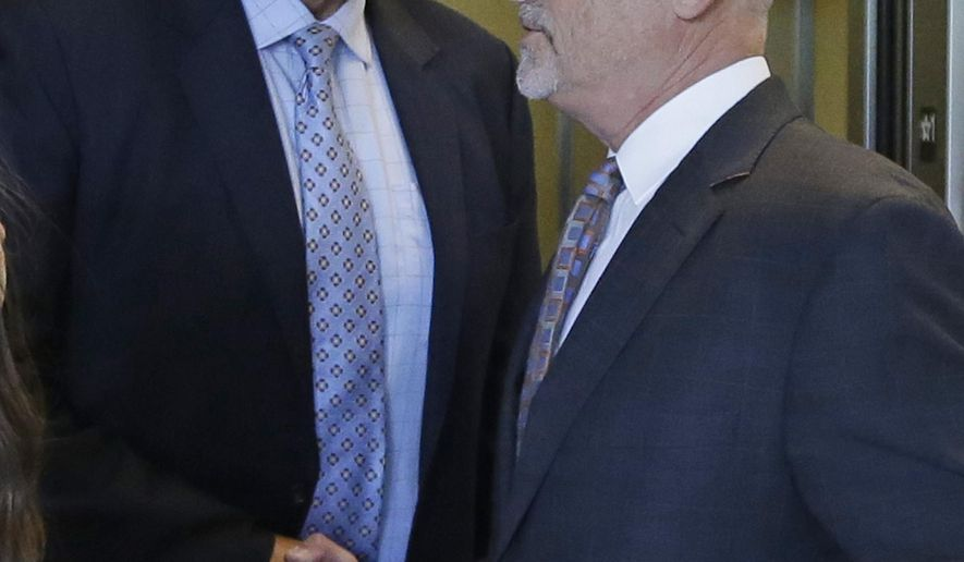 Former Utah Attorney General Mark Shurtleff, left, shakes hands with his attorney, Rick Van Wagoner, following a hearing Monday, June 15, 2015, in Salt Lake City. Prosecutors are dropping felony bribery charges against Shurtleff, but he still faces seven other charges, including accepting a prohibited gift and obstruction of justice. (AP Photo/Rick Bowmer)