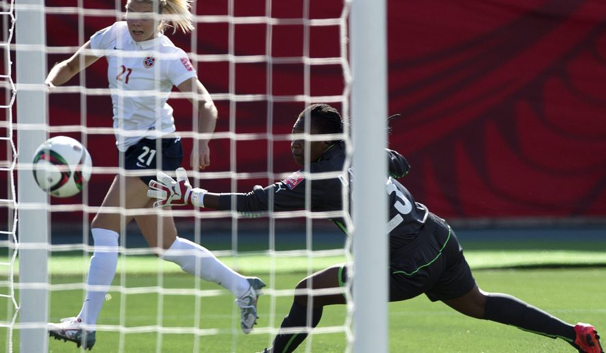 Norway's Ada Hegerberg scores on Ivory Coast's Cynthia Djohore during FIFA Women's World Cup first half soccer action in Moncton, New Brunswick, Canada, on Monday, June 15, 2015.  (Andrew Vaughan/The Canadian Press via AP) MANDATORY CREDIT
