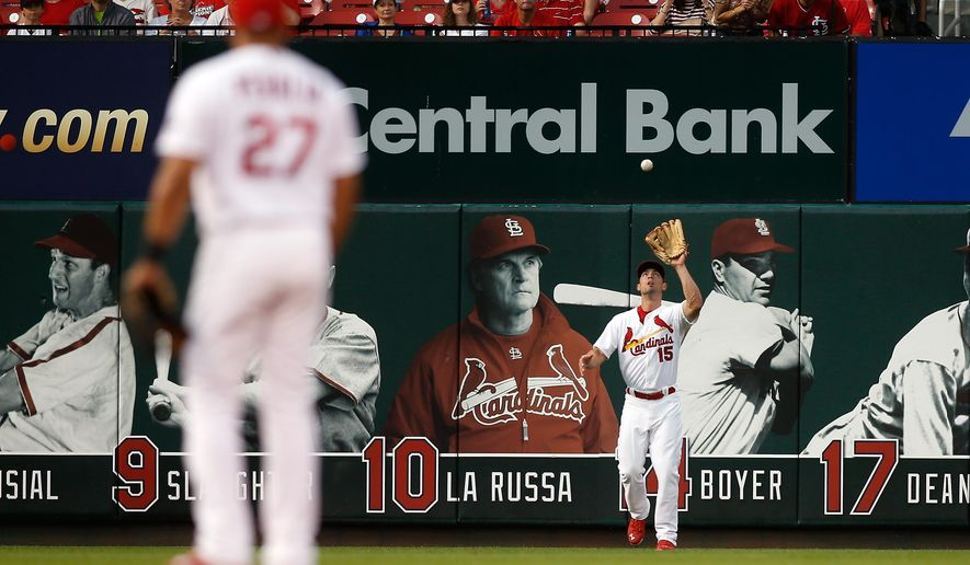 St. Louis Cardinals shortstop Jhonny Peralta, left, watches center fielder Randal Grichuk  make a catch to end the top of  the first inning of a baseball game against the Minnesota Twins Monday, June 15, 2015, in St. Louis. (AP Photo/Scott Kane)