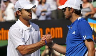 FILE- In this Jan. 23, 2007, file photo, Andy Roddick, left, of the United States, is congratulated by compatriot Mardy Fish after their quarterfinal match at the Australian Open tennis tournament in Melbourne, Australia. The pair will play doubles together at the BB&T Atlanta Open next month, and Fish is also going to attempt another comeback in singles.   (AP Photo/Andrew Brownbill, File)