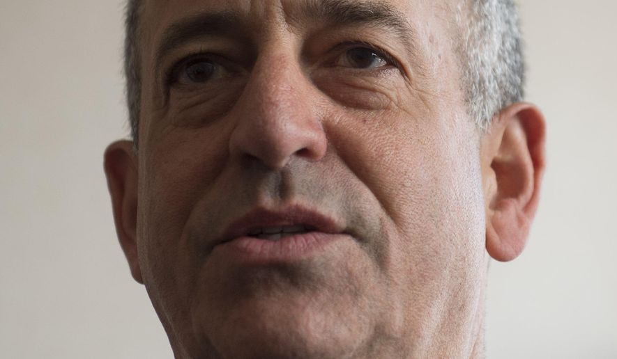 FILE - In a May 4, 2014, file photo, Russ Feingold, U.S. Special Envoy for the Great Lakes Region of Africa and the Democratic Republic of Congo, speaks during a press briefing at the Palais de la Nation in Kinshasa, Democratic Republic of Congo. The political action committee founded by former U.S. Sen. Russ Feingold spent most of its money on fundraising and only gave 5 percent of its income to federal candidates and political parties, based on data compiled by OpenSecrets.org released on Monday, June 15, 2015. Feingold, a longtime champion of campaign finance reform, is running for the Senate against Republican Sen. Ron Johnson who knocked him out of office in 2010.  (AP Photo/Saul Loeb, Pool. File)