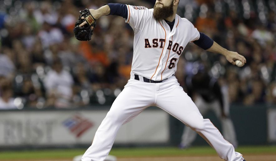 Houston Astros' Dallas Keuchel delivers a pitch against the Colorado Rockies during the first inning of a baseball game Monday, June 15, 2015, in Houston. (AP Photo/Pat Sullivan)