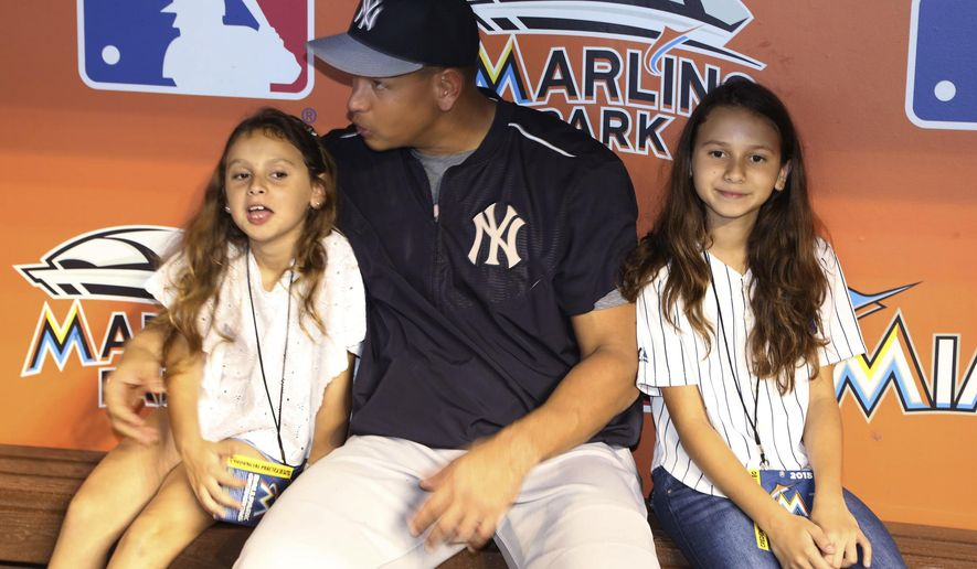 New York Yankees' Alex Rodriguez sits in the dugout with his daugthers Ella Rodriguez, left, 7, and Natasha Rodriguez, 10, before the Yankees' baseball game against the Miami Marlins on Monday, June 15, 2015, in Miami. (Hector Gabino/El Nuevo Herald via AP)