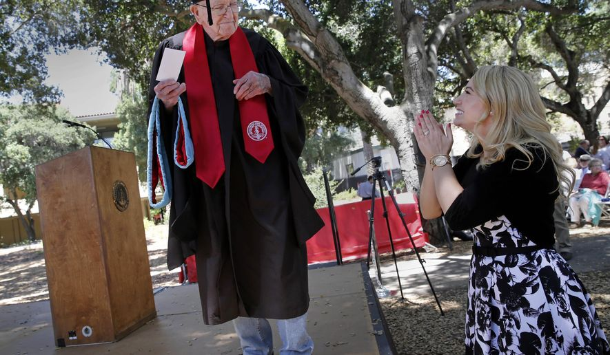 """In this photo made Sunday, June 14, 2015, Crystal Gould Sturgis applauds her grandfather, Bonnie Gould, as he rehearses his graduation on the Stanford University campus in Stanford, Calif. Bonnie """"Chuck"""" Gould got a master's degree in education from Stanford University in 1954, but it wasn't until this week that the 93-year-old formally graduated. Gould attended commencement ceremonies Sunday, receiving a standing ovation from the 208 other Graduate School of Education graduates when he took the stage. (Brant Ward/San Francisco Chronicle via AP)    MANDATORY CREDIT PHOTOG & CHRONICLE; MAGS OUT; NO SALES"""
