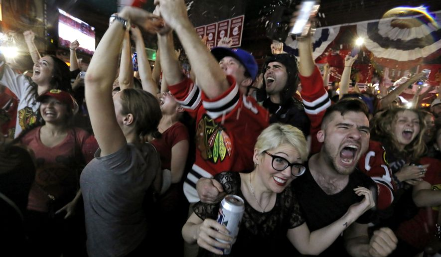 Chicago Blackhawks fans celebrate the Wrigleyville neighborhood of Chicago after the Blackhawks defeated the Tampa Bay Lightning to win the NHL hockey Stanley Cup on Monday, June 15, 2015, in Chicago. (AP Photo/Christian K. Lee)