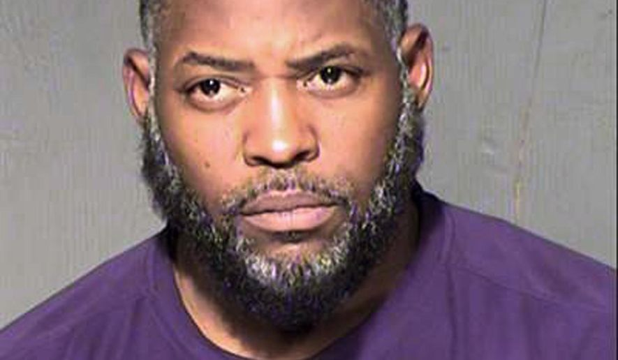 This undated law enforcement booking photo from the Maricopa County, Ariz., Sheriff's Department shows Abdul Malik Abdul Kareem. Kareem, 43, also known as Decarus Thomas, has been charged with helping plan an attack on a provocative Prophet Muhammad cartoon contest in Texas that ended with two men being killed in a shootout with police. An indictment filed in federal court in Phoenix alleges that Kareem hosted the gunmen in his home beginning in January and provided the guns they used in the May 3 shooting in Garland, Texas.(Maricopa County Sheriff's Department via AP)