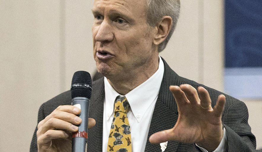"""FILE - In this May 1, 2015, file photo, Illinois Gov. Bruce Rauner speaks to members of the Greater Belleville Chamber of Commerce in Belleville, Ill. Rauner has latched onto the longtime rivalry between Chicago and the rest of Illinois as he tries to negotiate the budget with the Legislature's top Democratic leaders. Last week Rauner visited several communities around the state to promote what he refers to as his """"turnaround agenda."""" At a Marion motorcycle shop he said, """"This is about the Chicago machine running the state versus the people.  Rauner criticized Democratic House Speaker Michael Madigan and Senate President John Cullerton, both of whom are from Chicago, as driving the """"Chicago machine."""" (Derik Holtmann/Belleville News-Democrat, via AP, File)"""