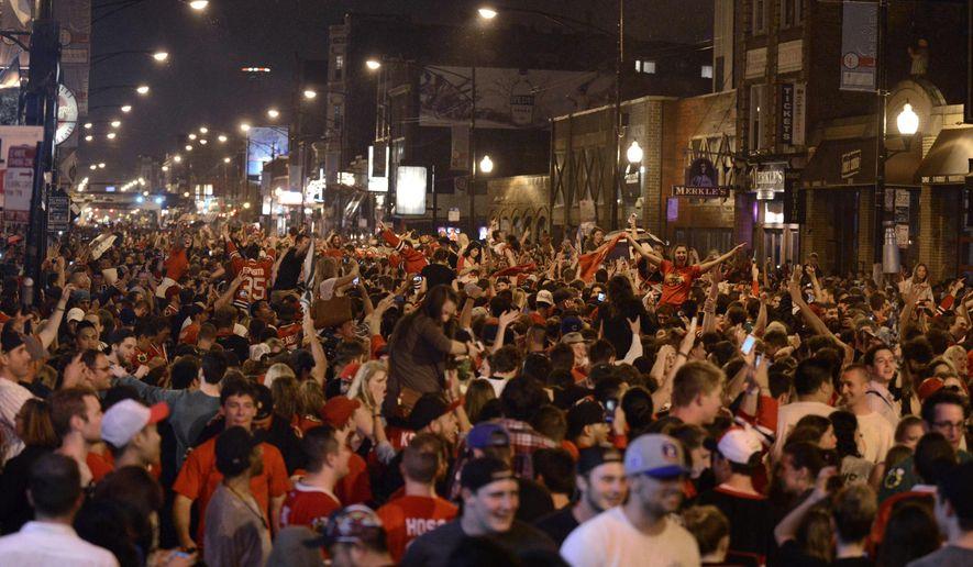 Chicago Blackhawks fans celebrate on Clark street in the Wrigleyville neighborhood after the Chicago Blackhawks won the Stanley Cup Monday, June 15, 2015 in Chicago. (AP Photo/Paul Beaty)
