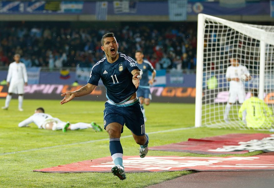 Argentina's Sergio Aguero celebrates after scoring the opening goal during a Copa America Group B soccer against Uruguay match at La Portada stadium in La Serena, Chile, Tuesday, June 16, 2015. (AP Photo/Andre Penner)